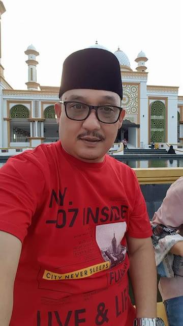 Kabid Pemberitaan Dinas Infokom Asahan Arbin Tanjung saat di Masjid Agung Kisaran.