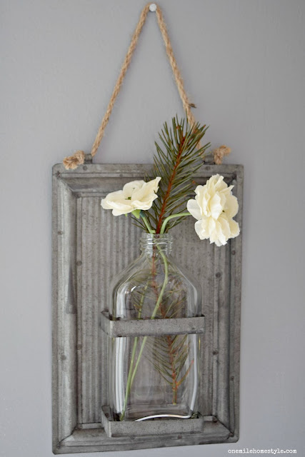Turn any flower arrangement into a winter display with a little added greenery