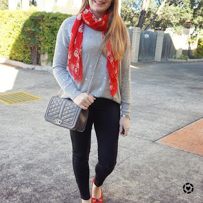 awayfromblue instagram foil print knit black skinny jeans red accessories with neutral sweater outfit