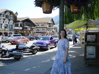Janel in a patchwork dress with the German tourist town of Leavenworth in the background
