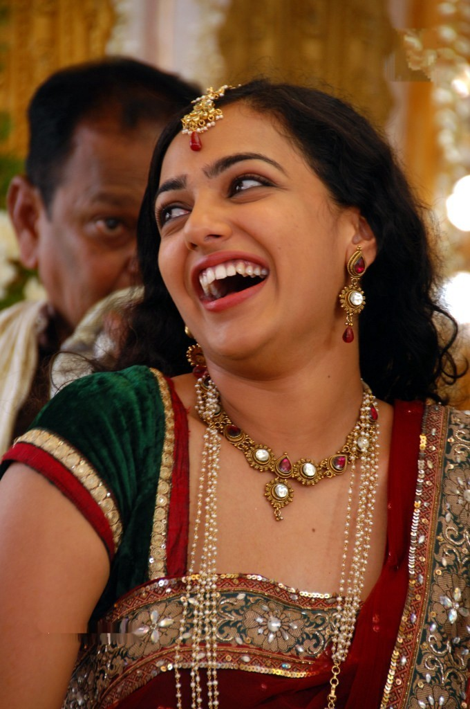 Nithya Menon Open Mouth Smiling Big Teeth Face Stills