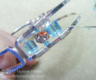 Adding crystals to a wire wrapped bracelet frame
