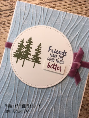 This picture shows a hand stamped card, showing trees and a sentiment made with the Waterfront stamp set and Rich Razzleberry Velvet Ribbon by Stampin' Up!