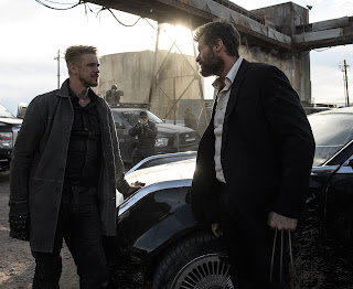 Hugh Jackman as Logan and Boyd Holbrook in Logan