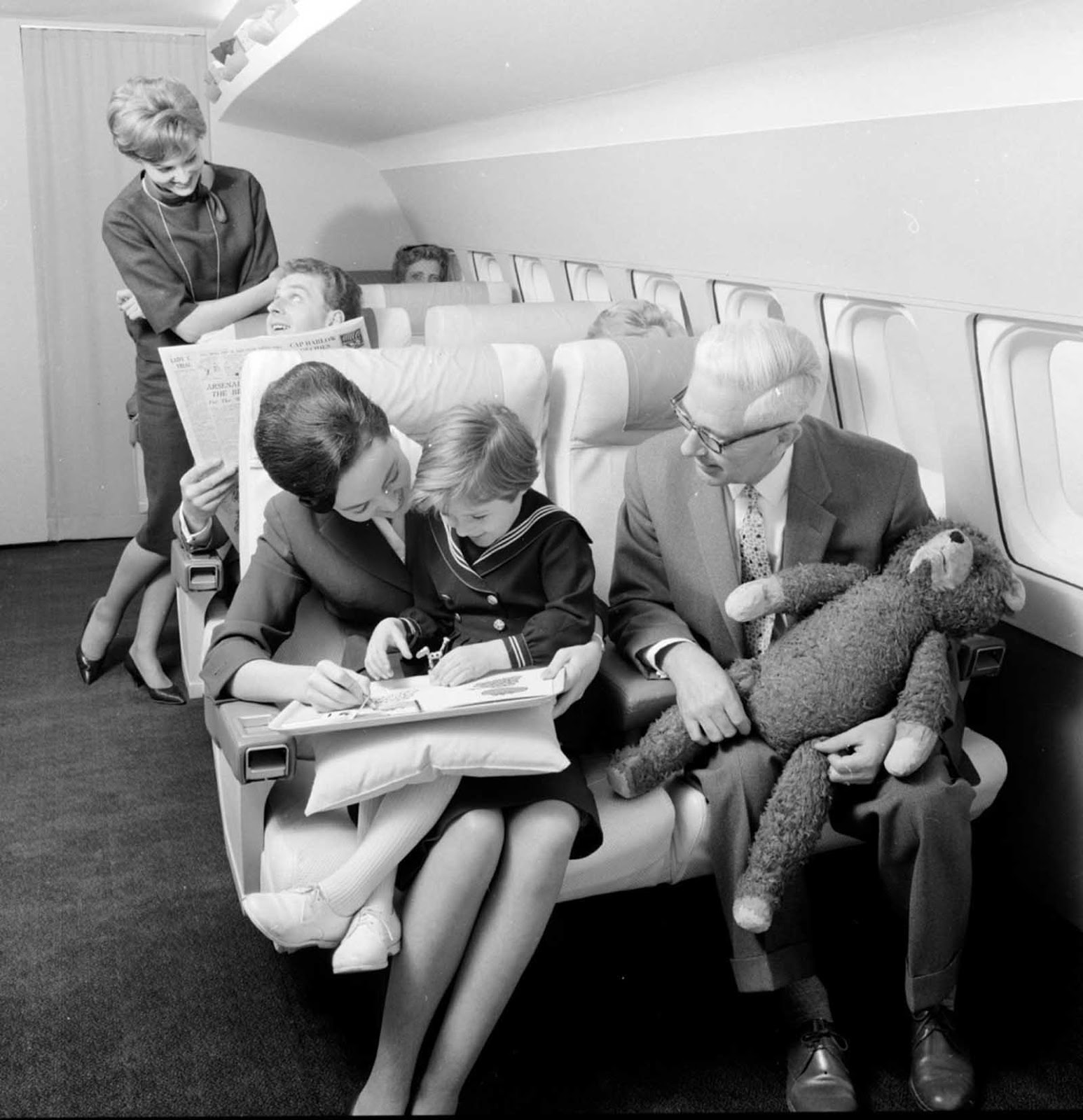A couple flying first class in 1960s.