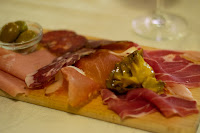 Sliced meats, olives and pickled vegetables at Ristorante da Dante in Rome, Italy.
