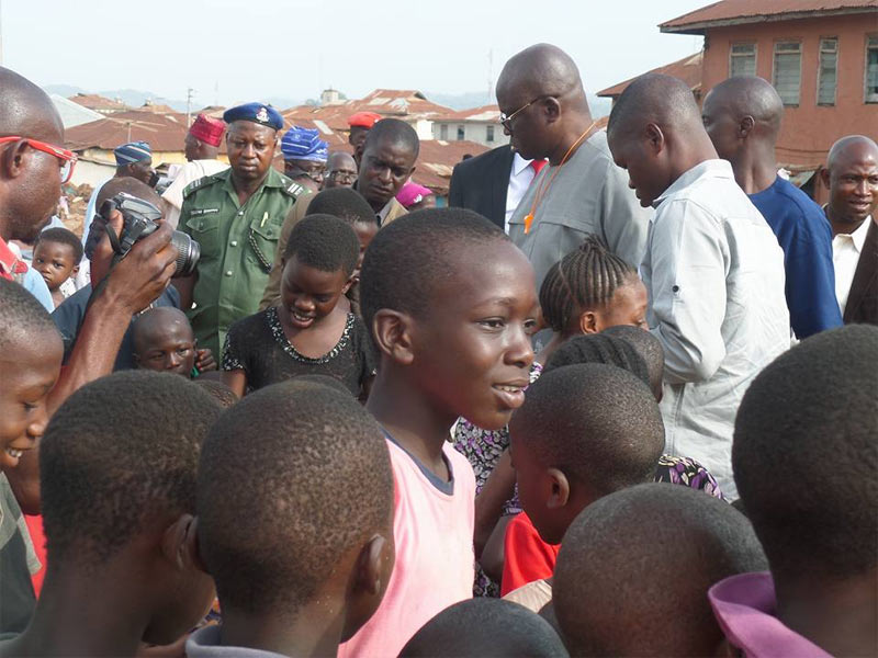 Governor Fayose shares cheese balls to Ekiti children