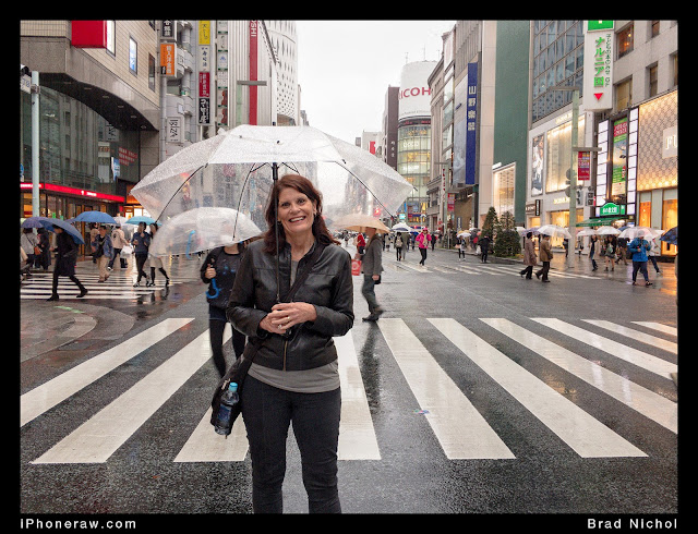 Main Street Ginza Japan in the Typhoon, lady under umbrella, no traffic