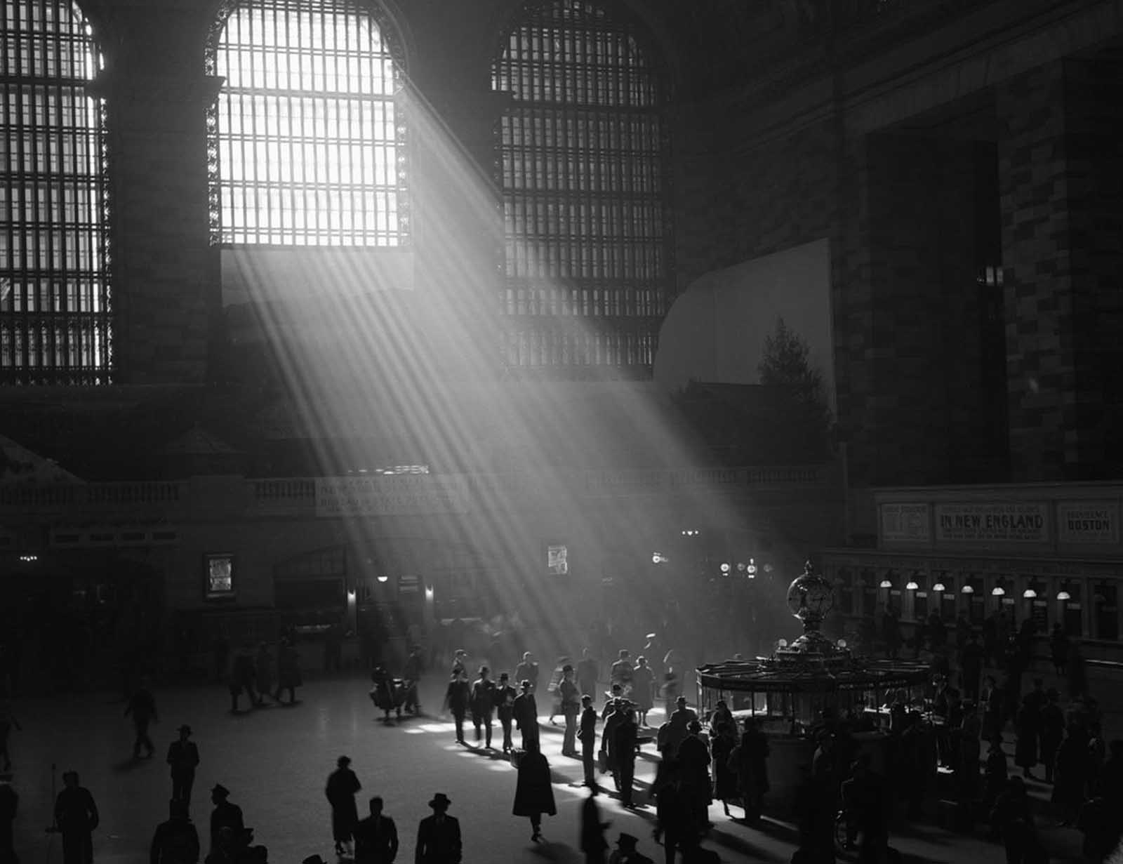 The interior of Grand Central Station, with the sun streaming in through the window.