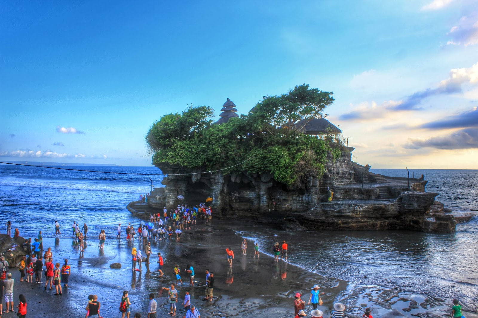 """tanah lot One of the most popular temples in bali is tanah lot (""""land in the sea"""") this  temple is built on a rock formation that juts off from bali it is said that a hindu."""