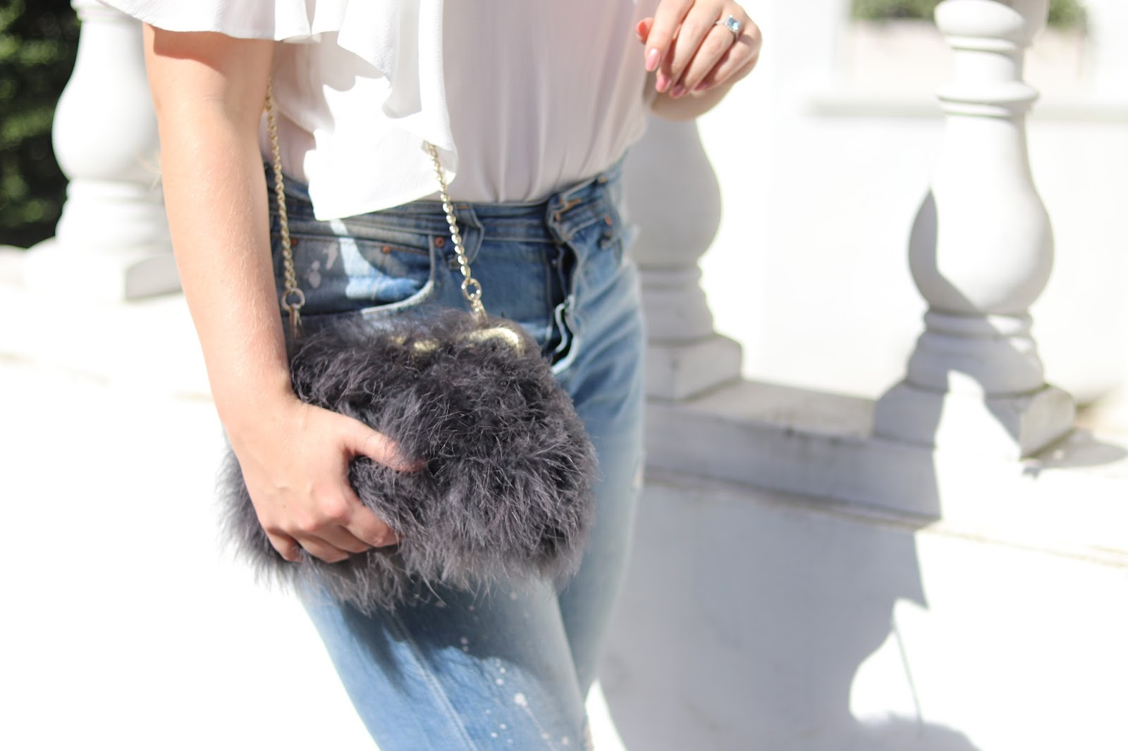 Blonde Girl, Katie Heath with Olaplex Haircare treatment, Hair by Dimitra, Michael John Salon, London, wearing Prada Sunglasses, Zara top and Jeans with Amelia Jane London Feather clutch bag