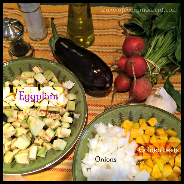Eggplant, beets and onion in a decorative display