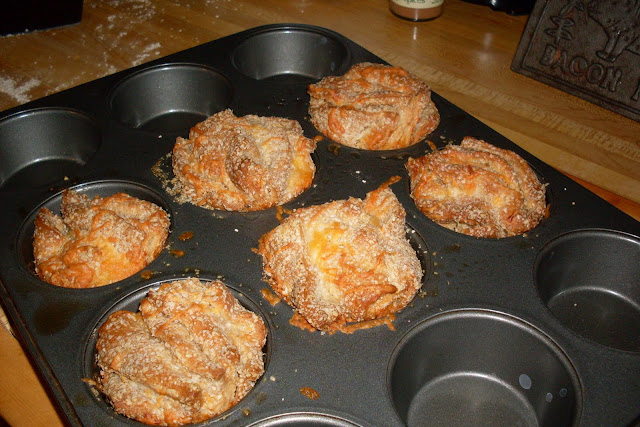 Layers of Cheese Biscuit Muffins, ready to serve.