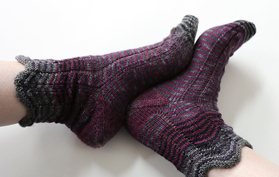 Wearing Socks Knit in Chevron Pattern with Purple Yarn