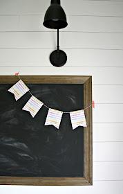 Chalkboard on white shiplap wall
