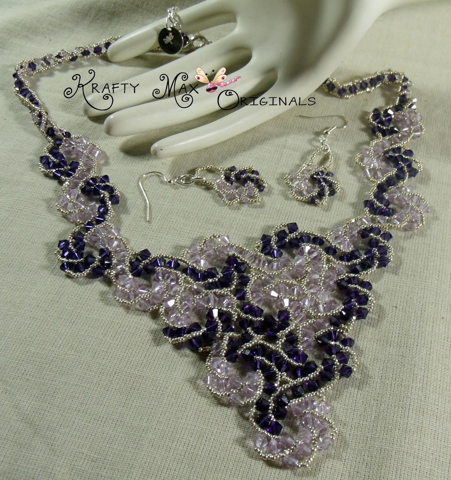 http://www.artfire.com/ext/shop/product_view/KraftyMax/7208177/purple_swarovski_crystal_swirl_beadwoven_lace_necklace_and_earrings/handmade/jewelry/necklaces/beadwoven