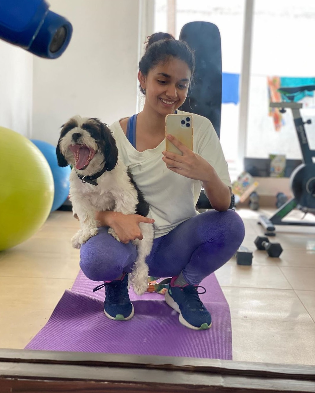 Keerthy Suresh in Blue and White Dress with Cute and Lovely Smile with her Cute Nyke Dog at Gym