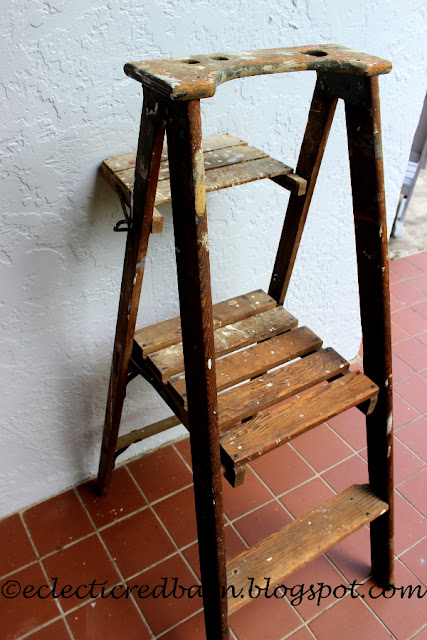 Eclectic Red Barn: Old ladder with platform step and curved top