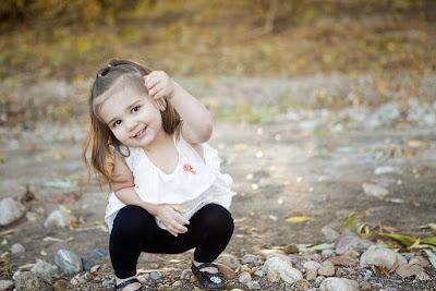 smally-girl-enjoing-on-rocks-dust
