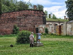 Grandmother and grandson walking a little black dog and playing in Terezín per Lihagen (Own work) [CC BY-SA 3.0 (http://creativecommons.org/licenses/by-sa/3.0) or GFDL (http://www.gnu.org/copyleft/fdl.html)], via Wikimedia Commons