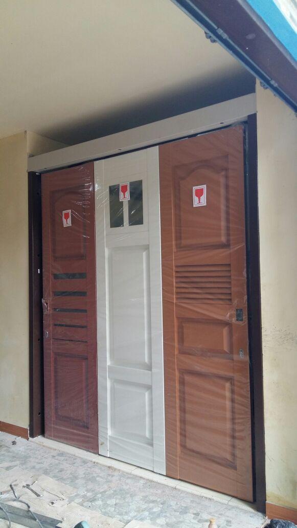 pintu garasi minimalis , pintu besi minimalis, rel pintu garasi , pintu garasi besi