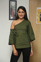 Pragya Jaiswal in a single Sleeves Off Shoulder Green Top Black Leggings promoting JJN Movie at Radio City 10.08.2017 051.JPG