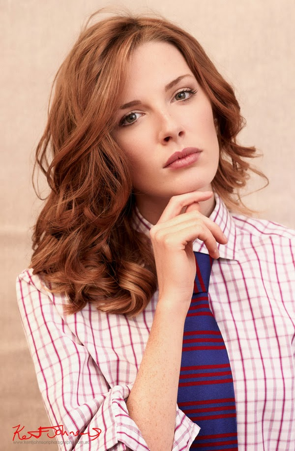 Hayley Wilson, Mid length Headshot, Green Eyes Red Hair, Annie Hall Style Headshot, Men's shirt and tie by Kent Johnson.
