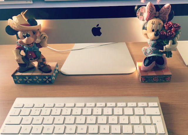 The Last 6 Questions for Morgan Prince | Morgan's Milieu: Mickey and Minnie figurines in front of a Mac