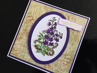Hand made birthday card with stamped and die cut larkspur flower