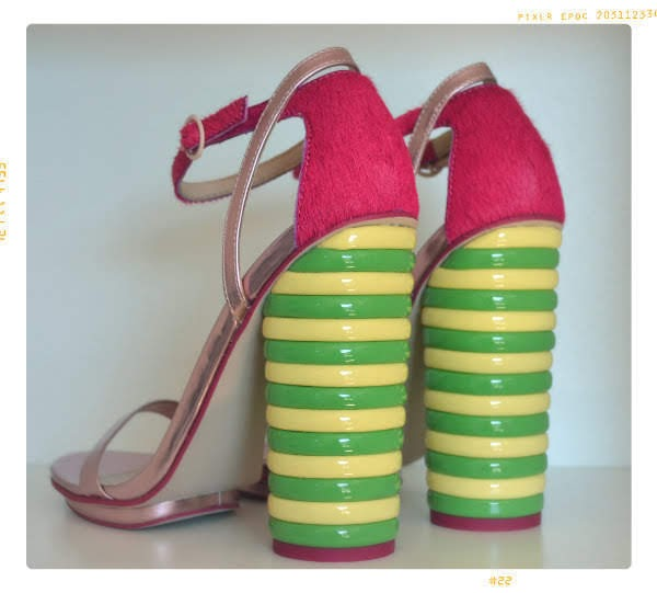 side back view of Twister heeled sandals in pink