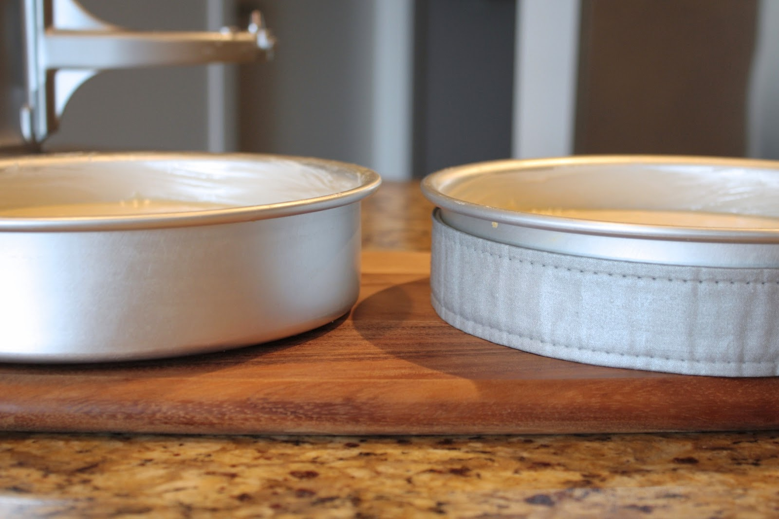 Side by side shot of cake pans, one with evenbake strip