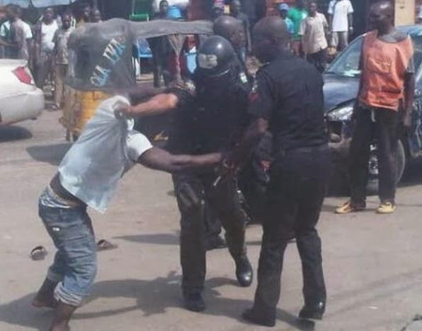 police fighting okadaman lagos