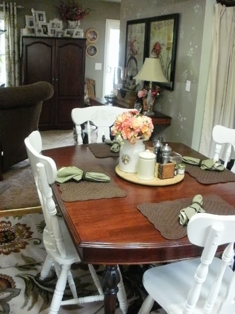 Mahogany table with white chairs
