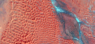 red dunes and blue river fantasy ,abstract landscapes of deserts of Africa