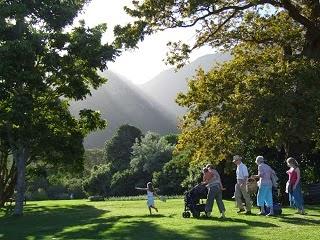 Families enjoy a weekend at a park.