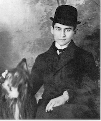 Franz Kafka, studio photo with hat and dog