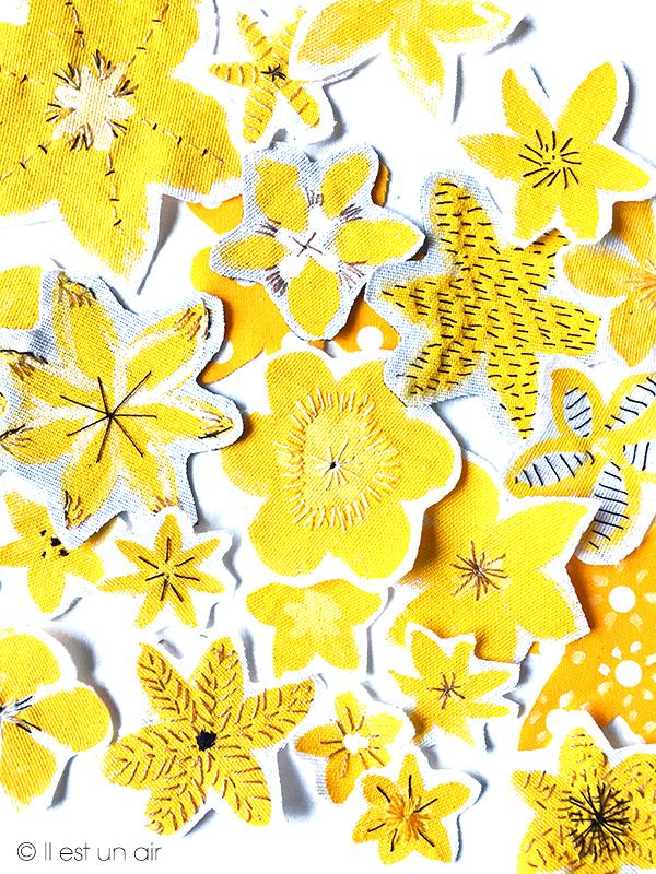 Fleurs jaunes peintes et brodées