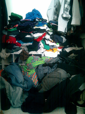 T-shirts on the floor of a closet