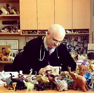 Dr. Abraham Chachoua with his elephant collection; photo by Kate Bornstein