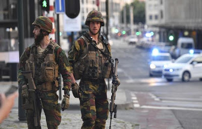 "Bomb blast on Brussel's Grand Central Station; Belgian police ""neutralize"" man wearing explosive belt"