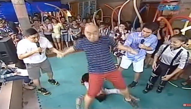 Wally Bayola trying an acrobatic routine