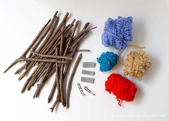 Broches con ramitas de arbol con lanas