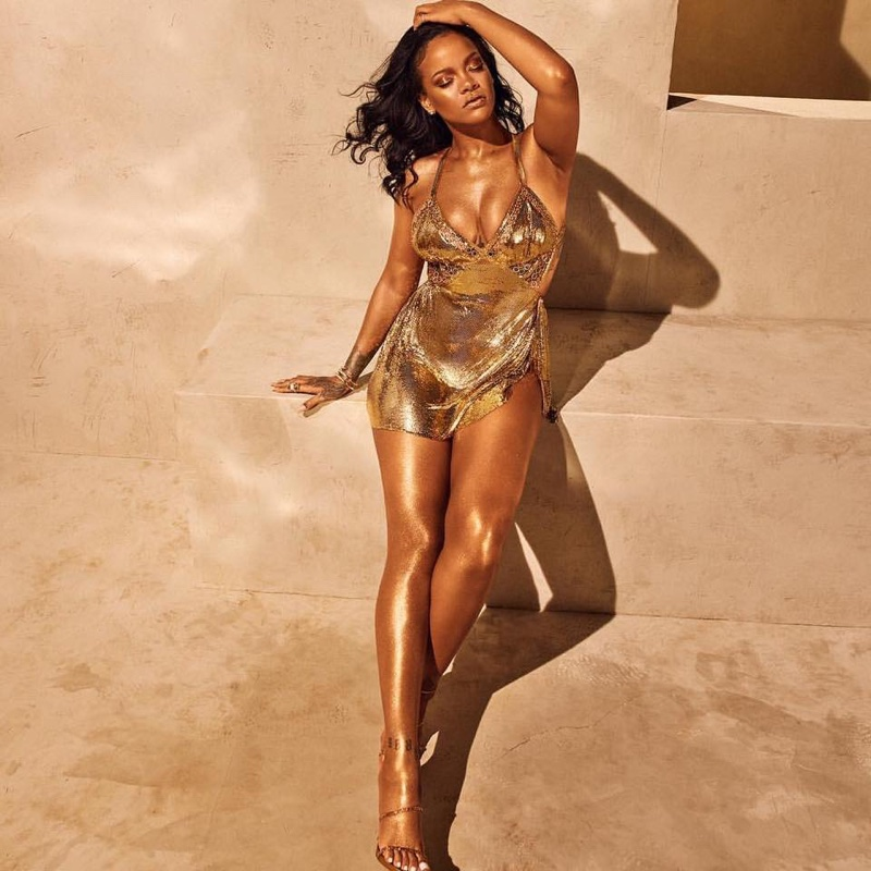 Rihanna shines in a gold dress for Fenty Beauty Body Lava campaign