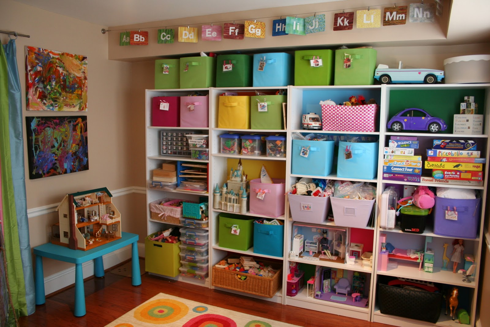 Pink and green mama kid friendly spaces and toy storage for Kid friendly family room design