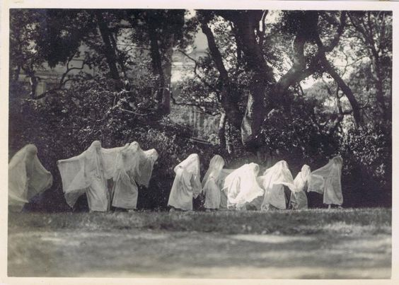 Vintage photo actors dressed as ghosts outside of an estate. Redbad Standards and Other Stories of Hell. marchmatron.com