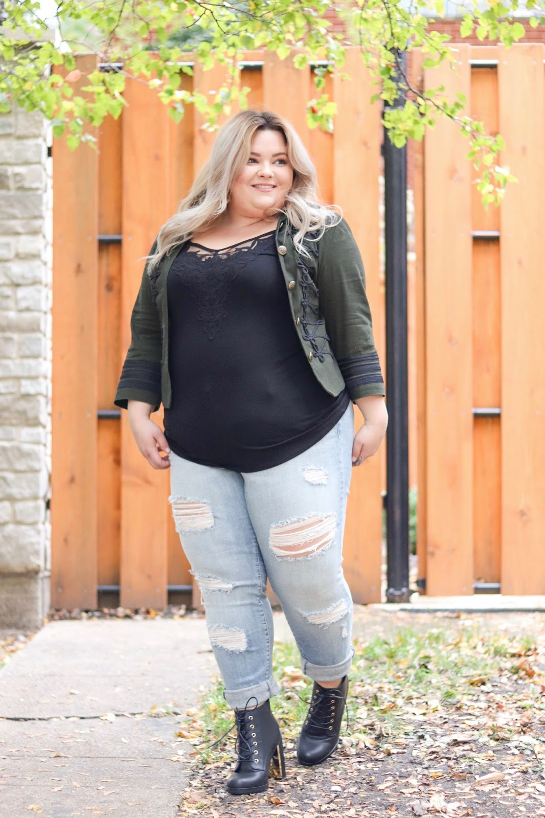 wide ankle combat boots, combat booties, natalie Craig, natalie in the city, plus size fashion blogger, Chicago fashion blogger, Chicago fashion, wide calf boots, wide fit boots, torrid, torrid boots, plus size boyfriend jeans, plus size military jackets, curves and confidence, affordable plus size clothing, gold heel shoes