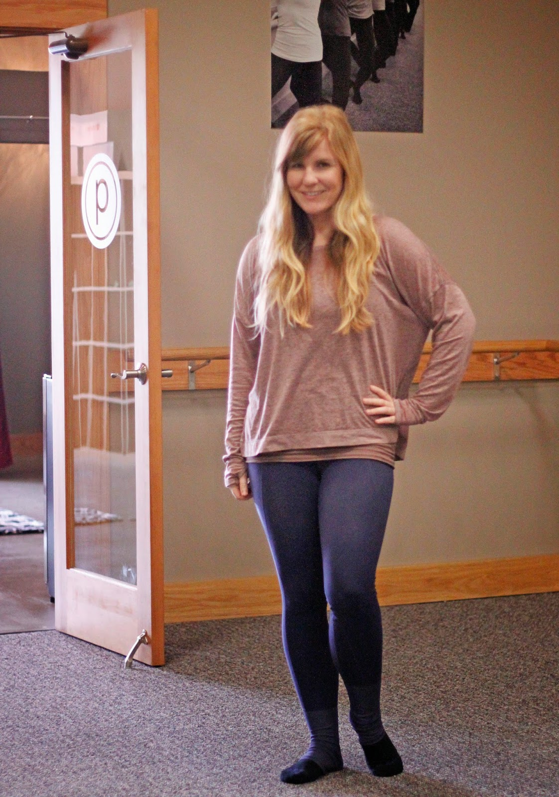 Bouncing back from baby at Pure Barre wearing Athleta