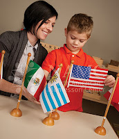 montessori teacher and boy with flags choosing NAMC montessori teacher training autism