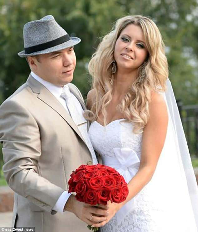 Ekaterina, pictured with her husband Igor, died after being put on a formalin drip instead of a saline drip.