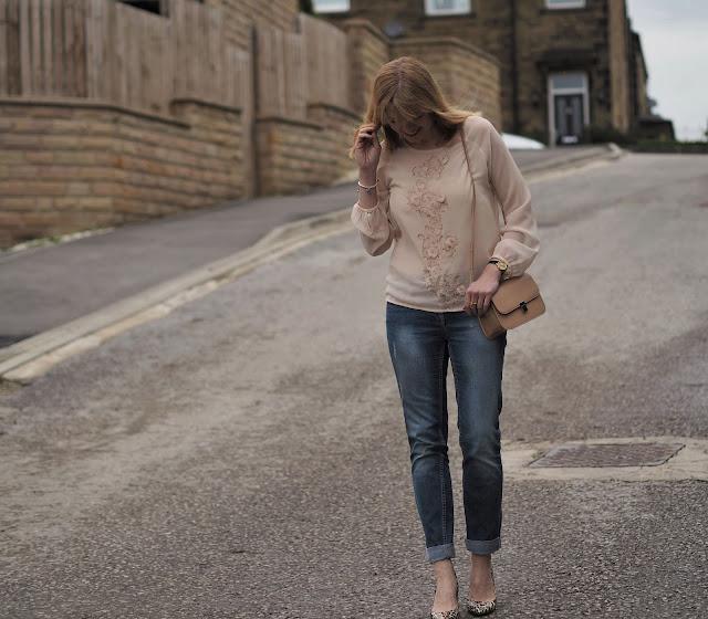 Blush pink embellished top, boyfriend jeans, leopard print bag. Over 40 fashion